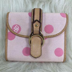 Dooney & Bourke pink polka dot trifold wallet.